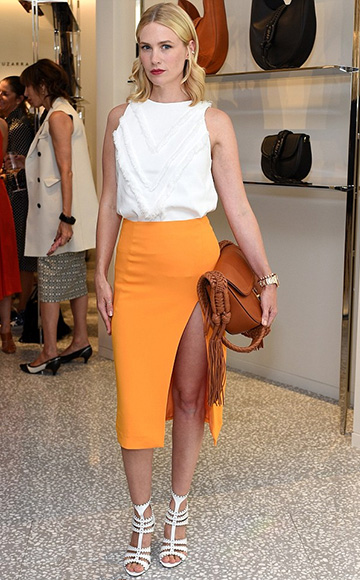 January Jones in Altuzarra Ghianda Small Saddle Bag and Sigerson Morrison Melania Dress Sandals to the Joseph Altuzarra luncheon hosted by Barneys New York in Beverly Hills, CA on September 24, 2015.
