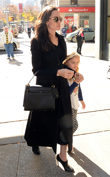 Angelina Jolie, in Versace sunglasses, Valentino bag and Jimmy Choo Rogue Leather And Velvet Booties, taking daughter Vivienne to Barnes & Noble in New York on November 3.