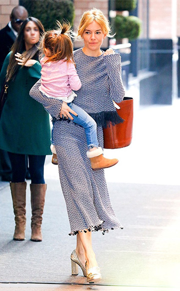 Sienna Miller, in a Derek Lam Fringe Hem Crochet Top and matching skirt plus Gucci Marmont pumps, leaving a New York City hotel with her daughter, Marlowe, on October 20.