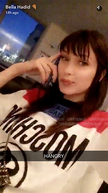 Bella Hadid wears a Moschino Oversized Mini Dress Sweater on her Snapchat story.