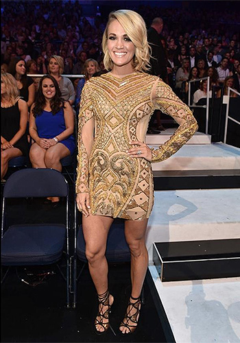 Carrie Underwood wearing a pair of Rene Caovilla Crystal-Embellished Suede Lace-Up Sandals to the 2016 CMT Music Awards on June 8, 2016.