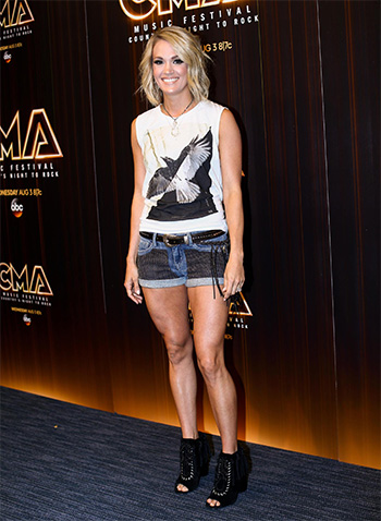 Carrie Underwood wearing a pair of Twelfth Street By Cynthia Vincent Nailed Booties to the 2016 CMA Music Fest Day 2 in Nashville on June 10, 2016.