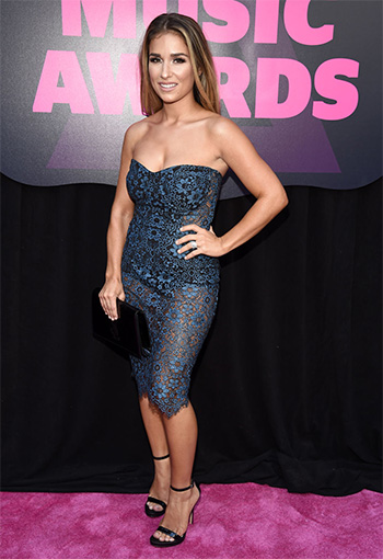 Jessie James Decker wears a For Love & Lemons Sophia Bustier Dress to the 2016 CMT Music Awards on June 8, 2016.
