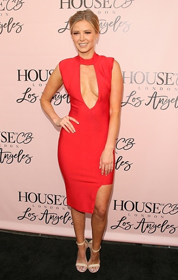 Ariana Madix wears a House Of CB Kamaria Red Asymmetric Bandage Dress to the House Of CB Flagship Store Launch in West Hollywood, CA on May 14, 2016.