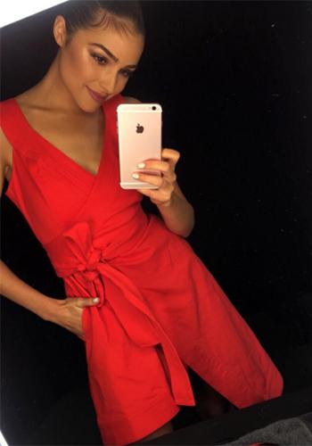 Olivia Culpo wears a Alexis Caterina Sleeveless Poplin Wrap Dress in Instagram shot.