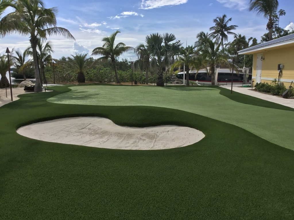Bunker and putting green at outdoor backyard FL Keys golfing project