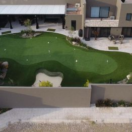 overhead view of synthetic grass backyard putting green
