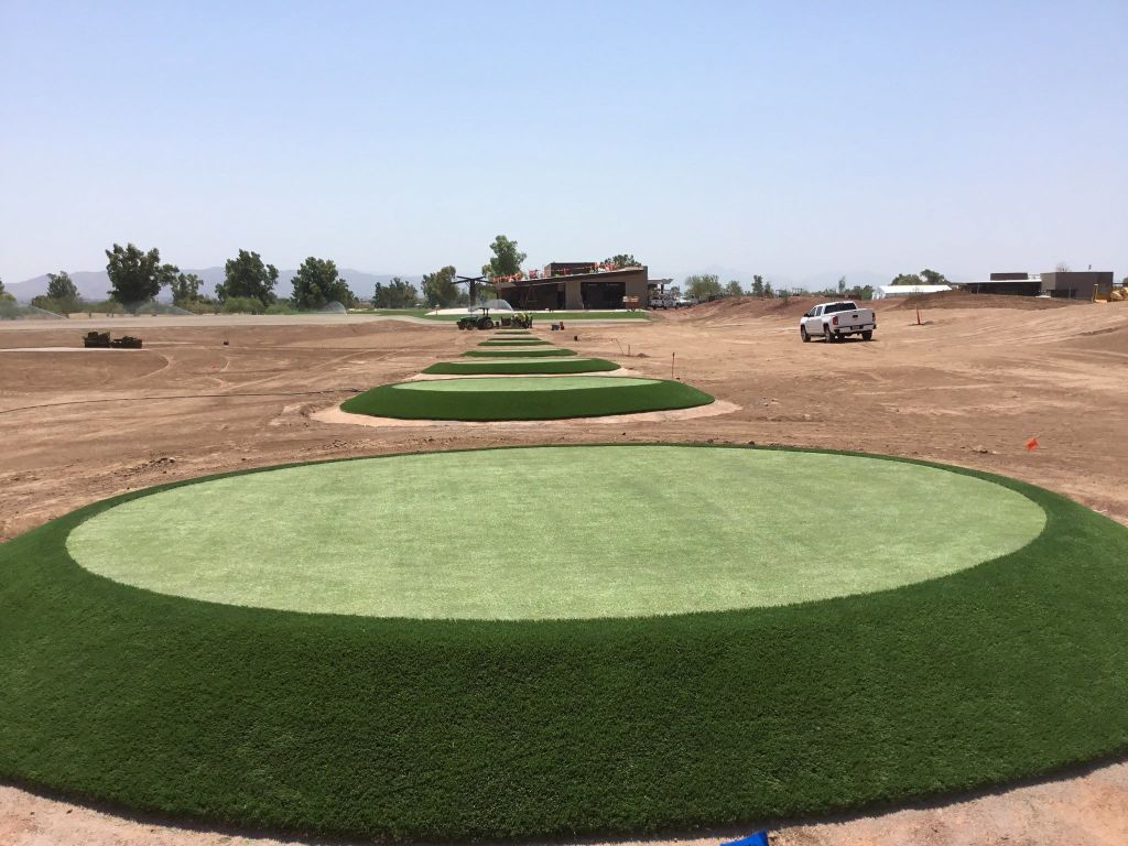 closeup of installation of target greens at Phil Mickelson's ASU Papago Golf Sports Complex