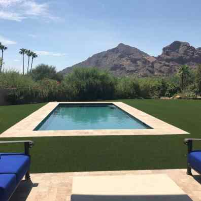 Backyard pool with artificial grass surround in Phoenix
