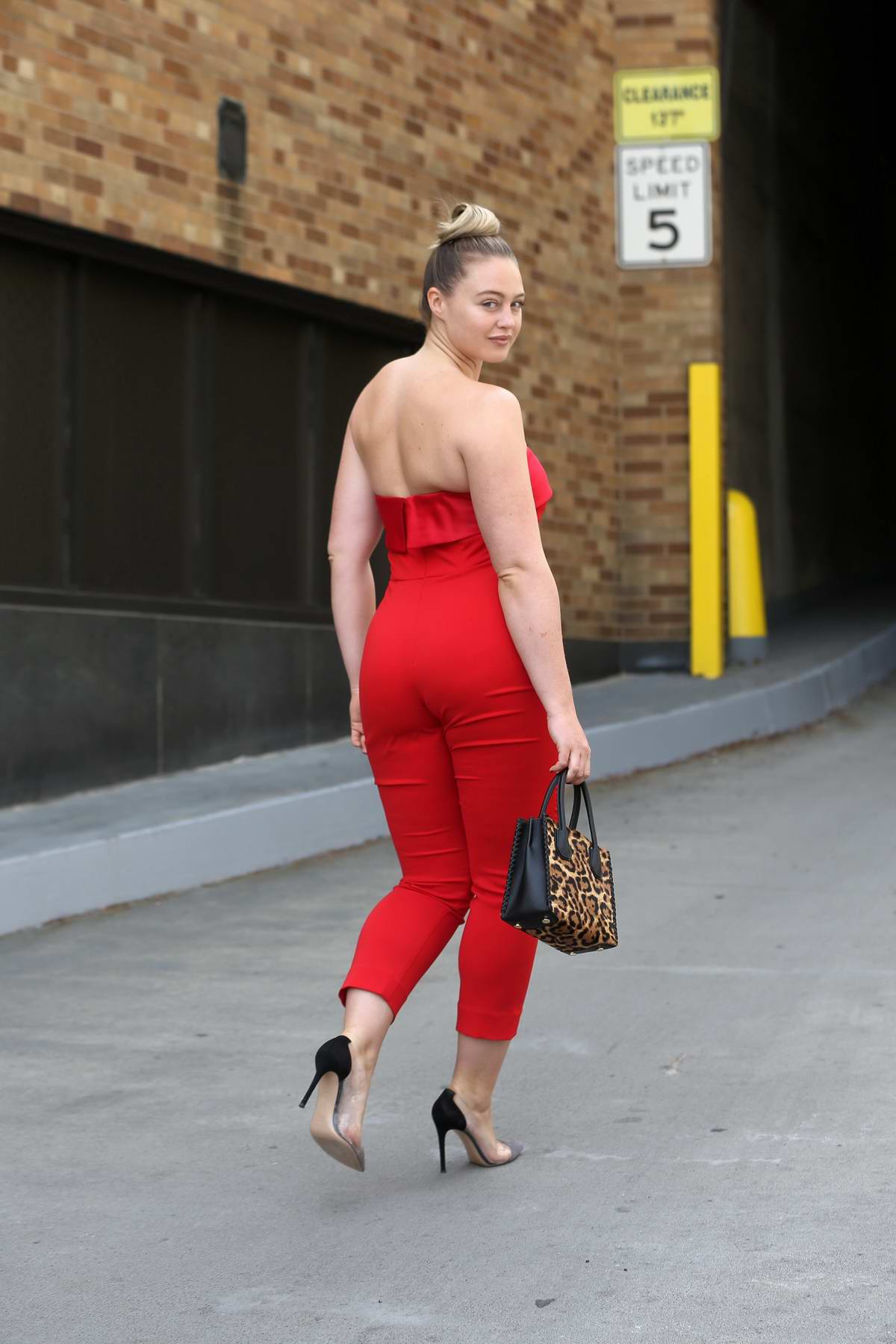 iskra lawrence wearing a red jumpsuit attends badgley