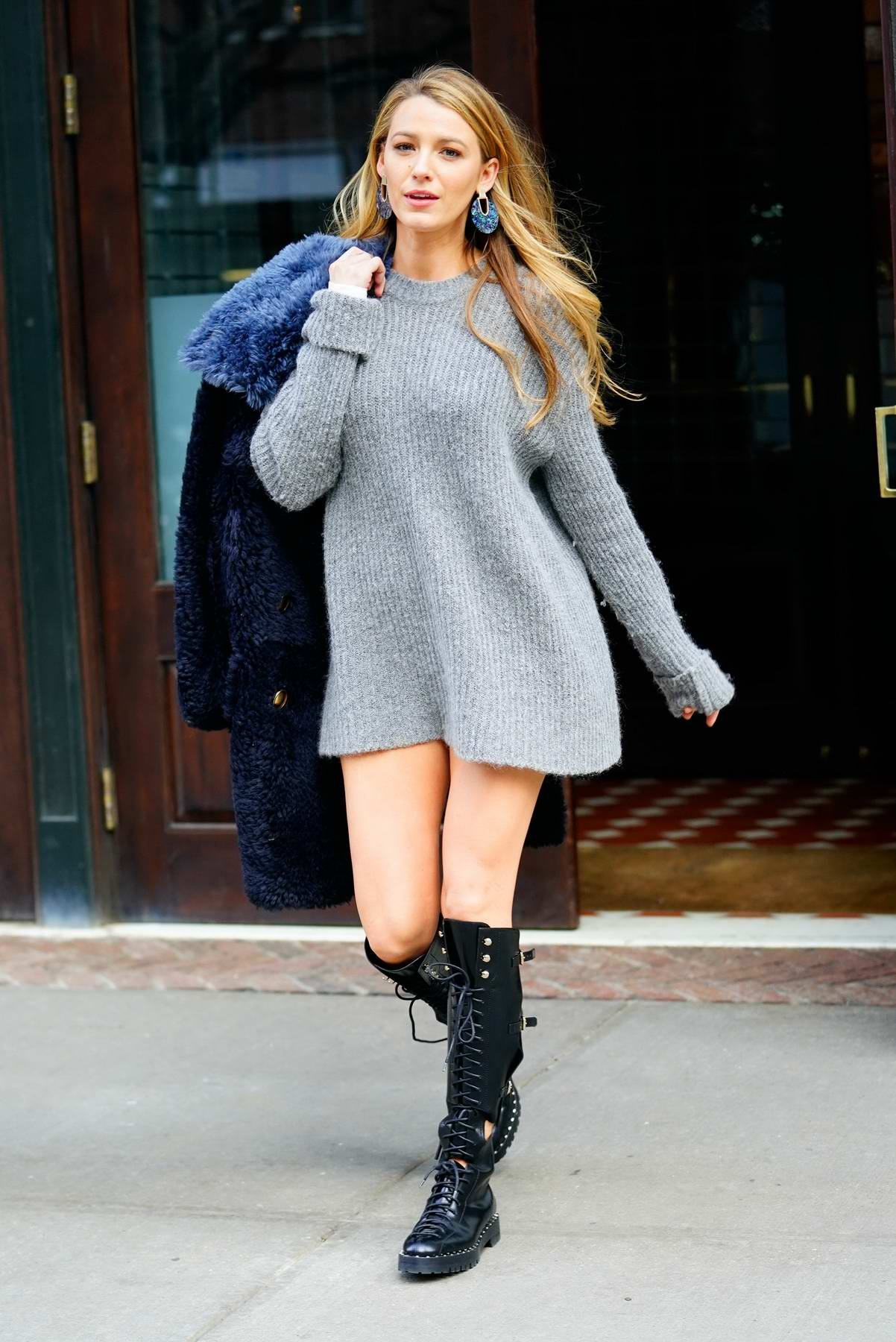 Blake Lively wears a grey sweater dress with kneehigh boots and blue fur coat while out in New