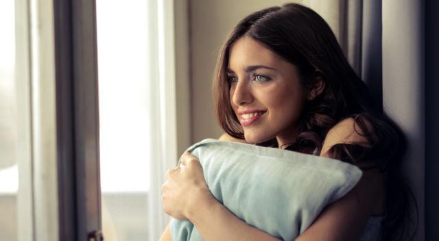 Woman contemplating PMS mood swings