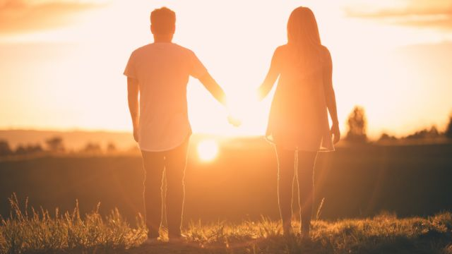 Couple holding hands in successful relationship