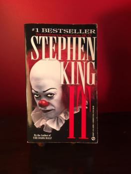 6c19e6a8f Sechrest s paperback copy of Stephen King s epic novel with Tim Curry s  face glaring at you from the cover.