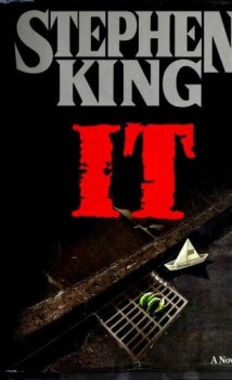 cover art of the first edition hardcover of IT, showing a green clawed monster hand reaching out of a sewer