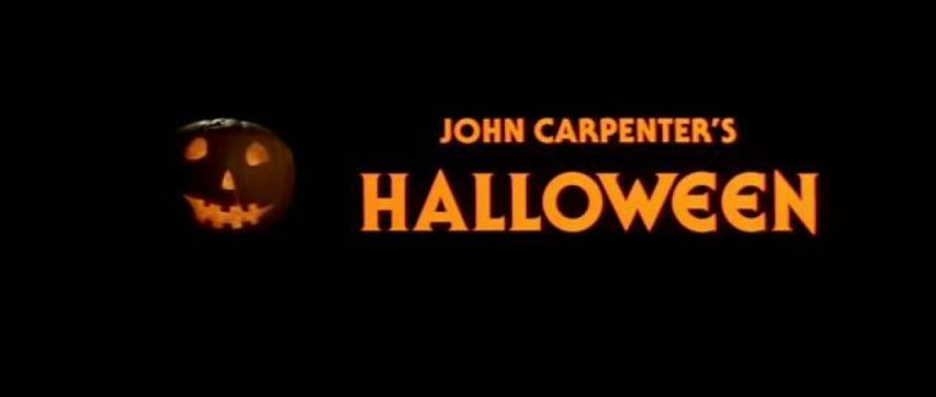 Black background with orange writing that says John Carpenter's Halloween. Also has a jack o' lantern