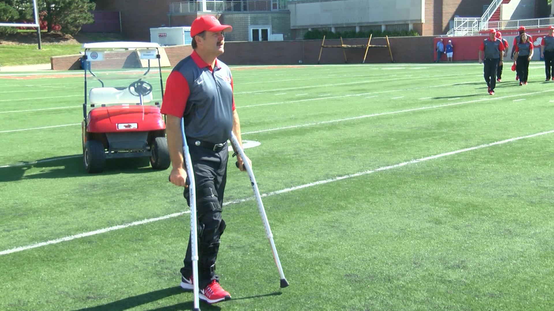 Brock Spack on crutches_1470888328165.jpg