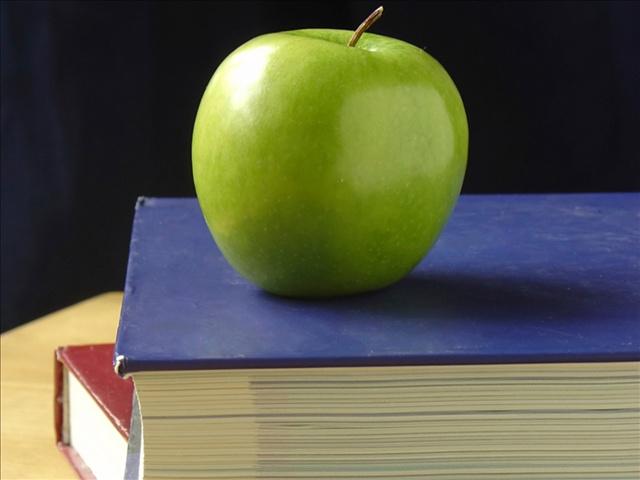 school books and apple_1509727604742.jpg