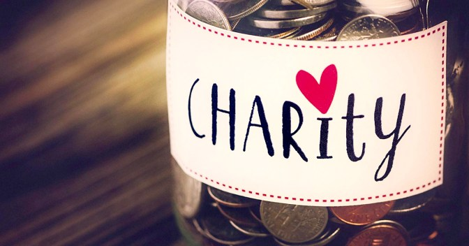 Charity money jar with coins