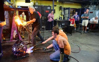 Stephen Powell did a glassblowing demonstration and a tour of his gallery space for the Alumni College on July 18, 2014.