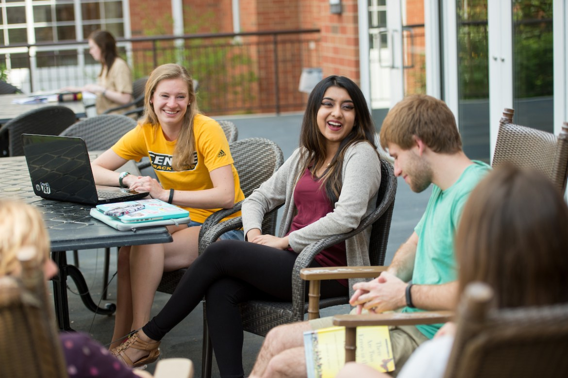 students relaxing outside of Pearl Hall