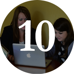 student and counselor sharing a laptop