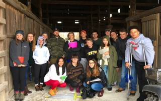 Students in Dr. Sarah Egge's Farm-to-Table course gather in a barn located on a centuries-old farm