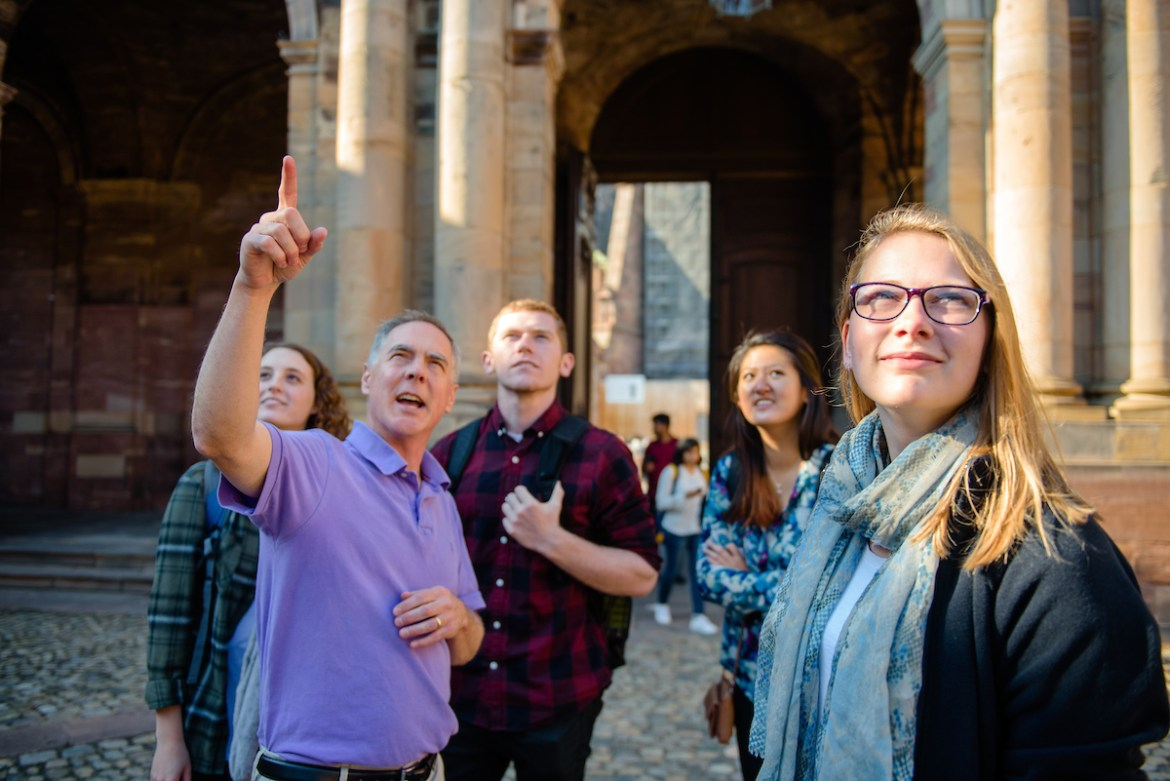 Professor Jeff Fieberg discusses architecture with students in France