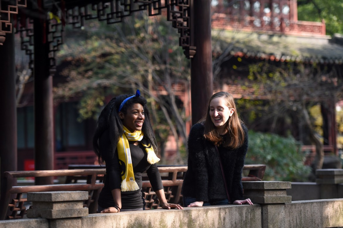 Two female students tour ancient buildings in Shanghai, China