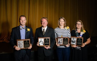 Athletic Hall of Fame inductees: (from left) Jeff O. Floyd '98, Steve Lubbe '94, Sarah Green-Robinson '02 and the widow of William Botts, Jr. '84