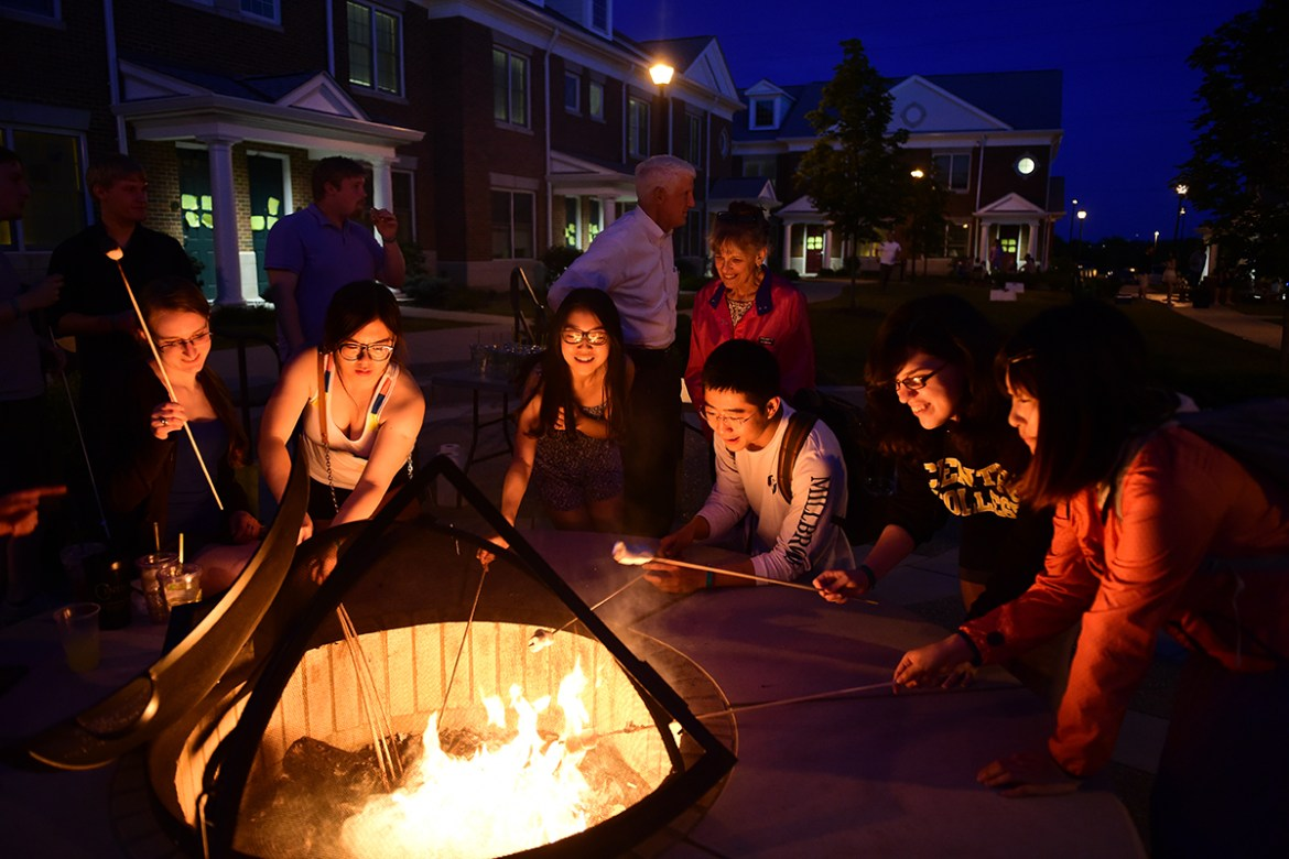 Graduating seniors relaxed by the firepit at the Brockman Commons and made S'mores with the Roush's as part of senior week on May 23, 2014.