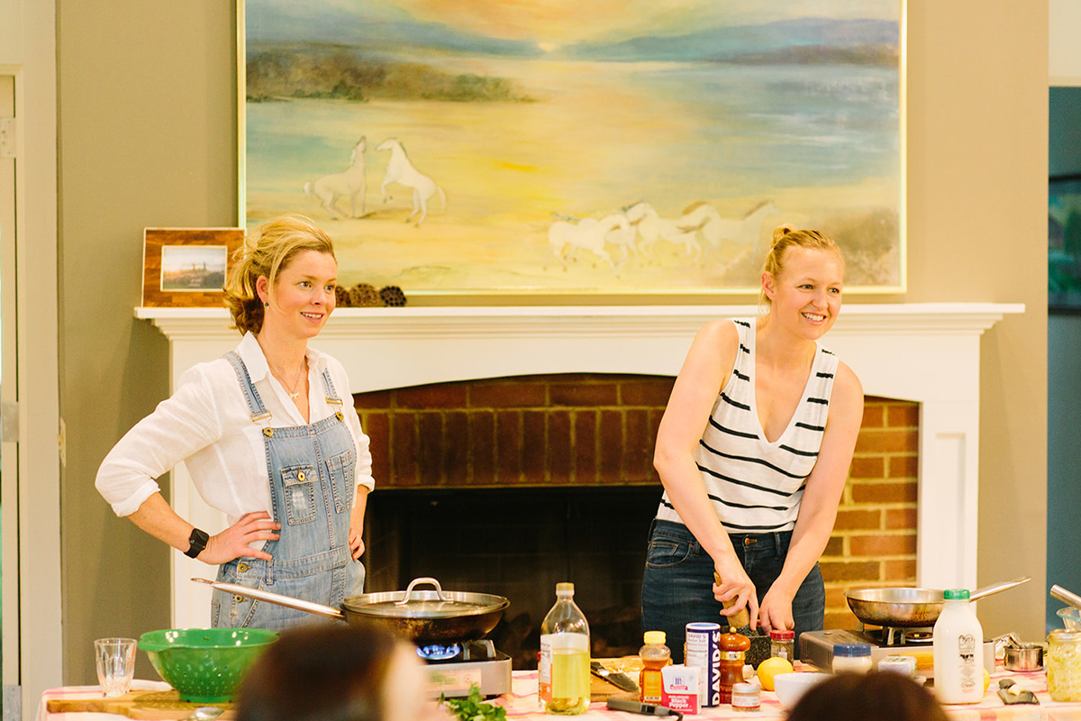 """Lindsey Stewart McClave '04 (right) and Maggie Keith teach a cooking class at Foxhollow Farm as hosts of """"The Farmer and The Foodie"""""""