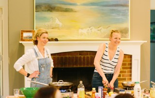 "Lindsey Stewart McClave '04 (right) and Maggie Keith teach a cooking class at Foxhollow Farm as hosts of ""The Farmer and The Foodie"""