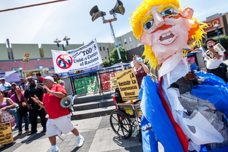 The Donald Trump piñata after being whacked a few times by immigration supporters during a rally at Mission and 16th streets against Donald Trump and his immigration remarks, Sunday, July 19, 2015, in San Francisco, California. Protesters marched along Mission Street and held a final demonstration at 24th Street.