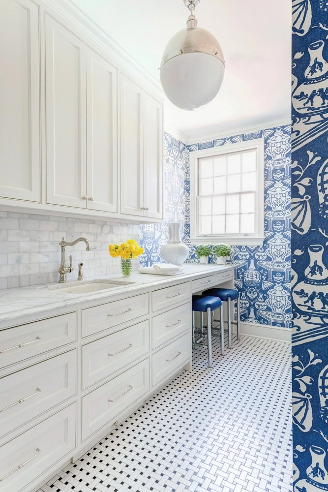 bold blue wallpaper laundry room