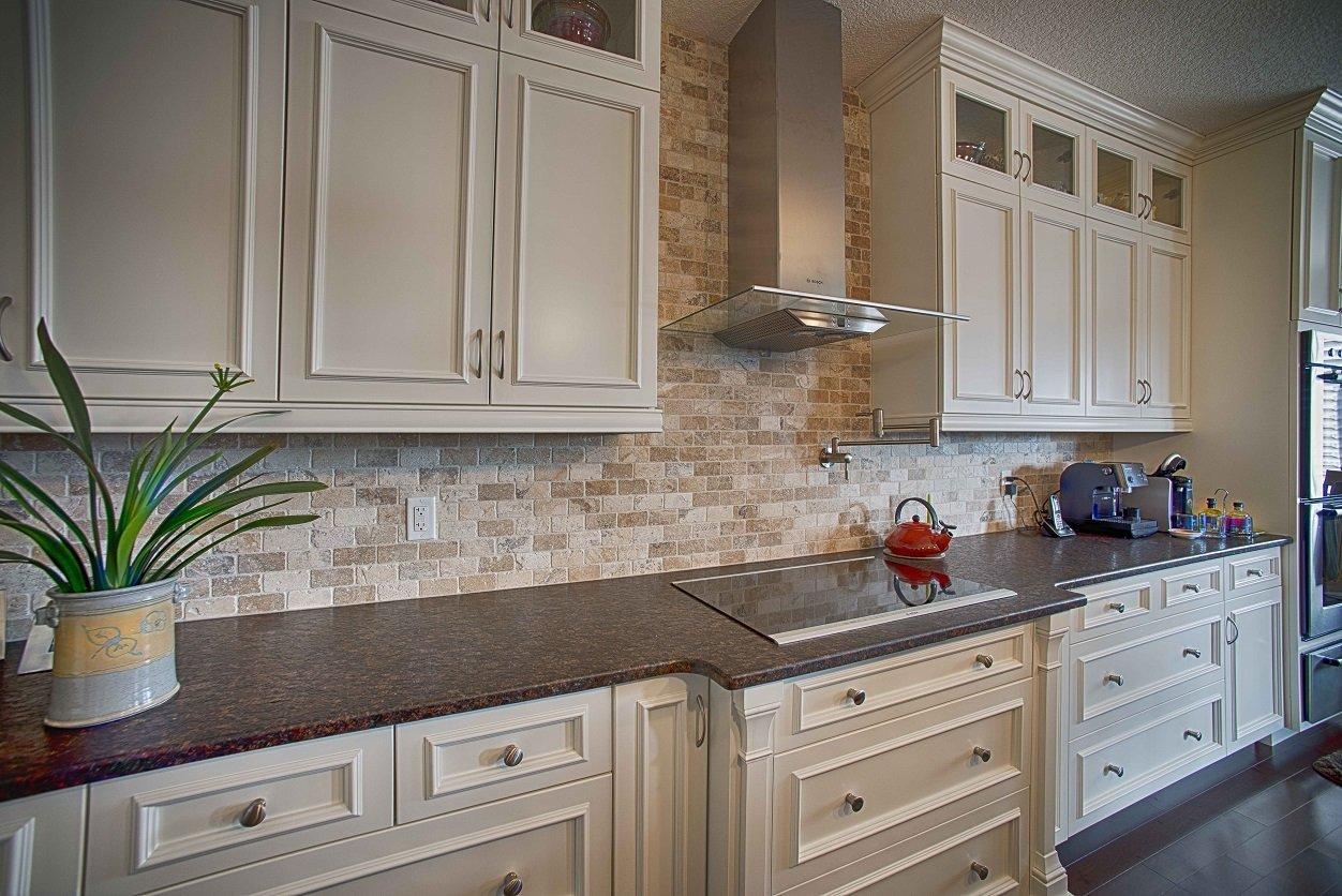 natural stone backsplash kitchen kohler faucet parts ceramic decor