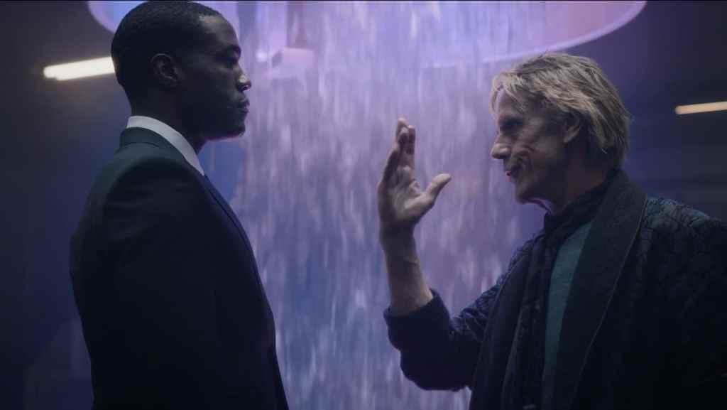 Adrian parla con Jon; dietro di lui il teletrasportatore