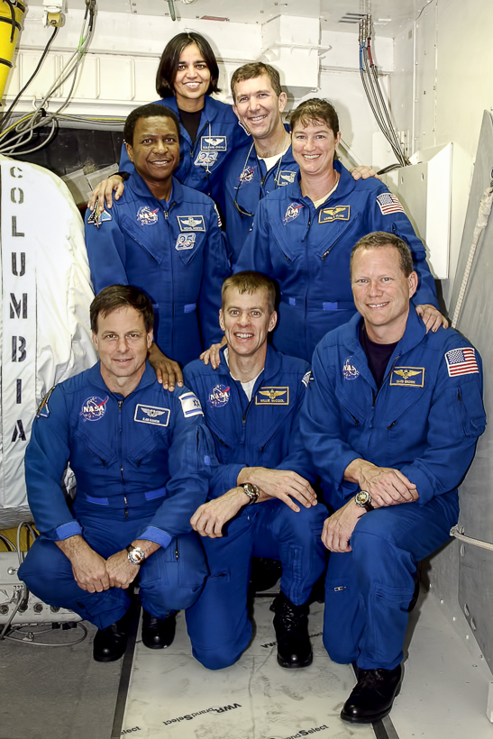 "STS-107 crew; in front are (left to right) Payload Specialist Ilan Ramon, Pilot William ""Willie"" McCool and Mission Specialist David Brown. Standing in back are (left to right) Payload Commander Michael Anderson, Mission Specialist Kalpana Chawla, Commander Rick Husband and Mission Specialist Laurel Clark"