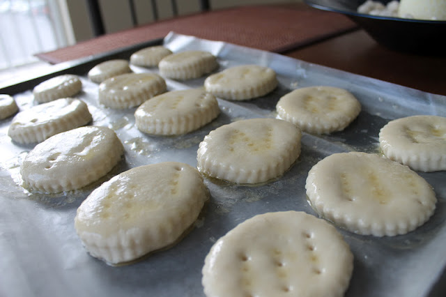 Biscuit Dough On A Cookie Sheet Covered In Melted Butter