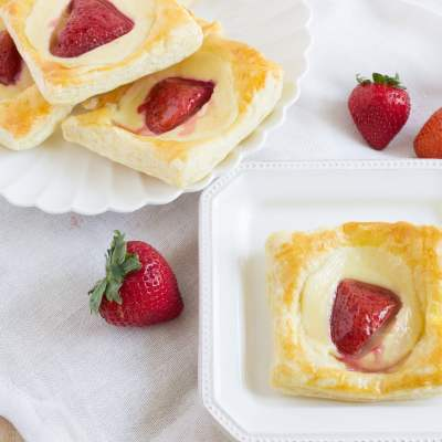 Strawberries & Cream Danish - A cream cheese danish made with puff pastry and then topped with a strawberry and a glaze made with apple jelly. It's the best addition to any breakfast or brunch!