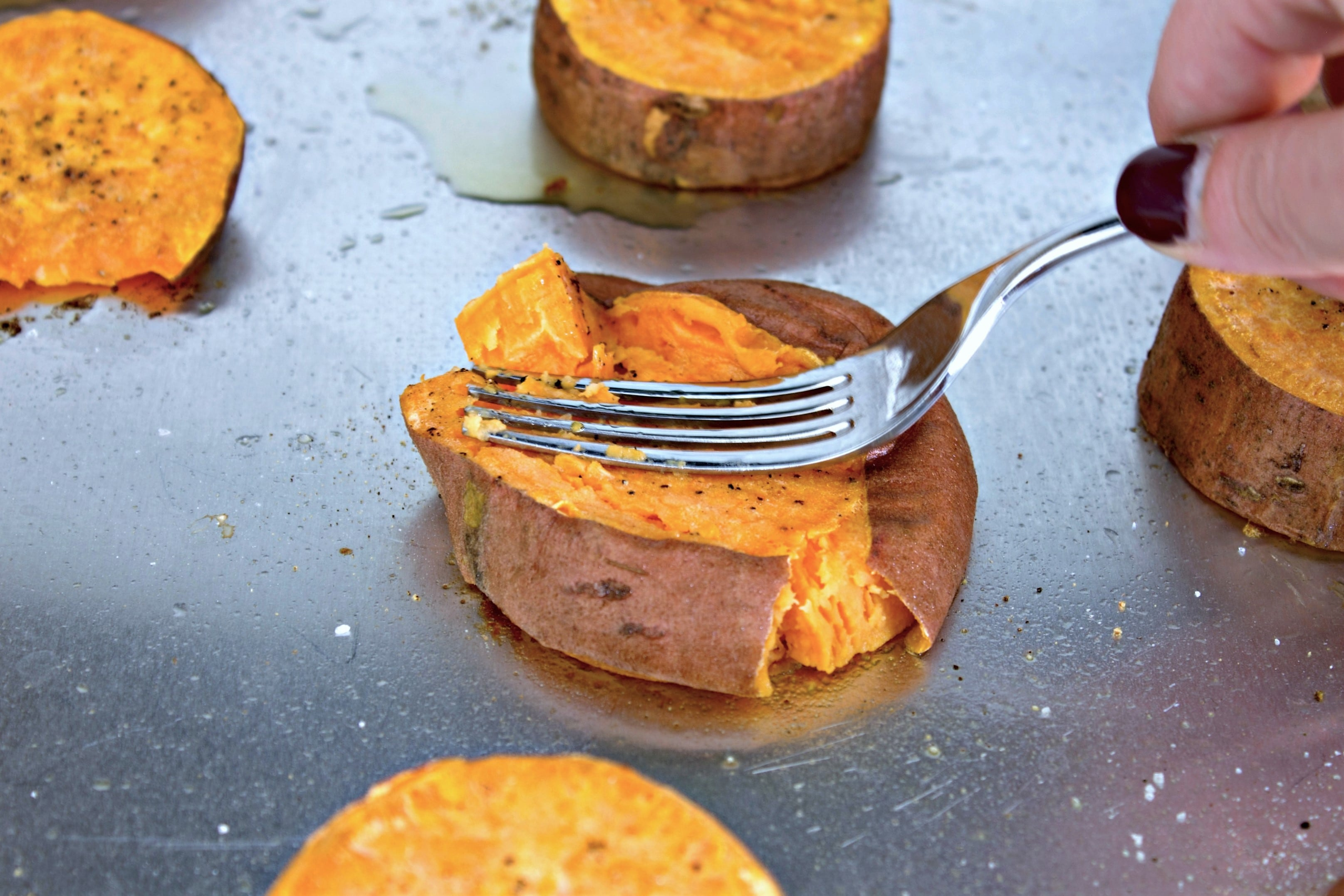 Smashing Sweet Potato Slices With A Fork