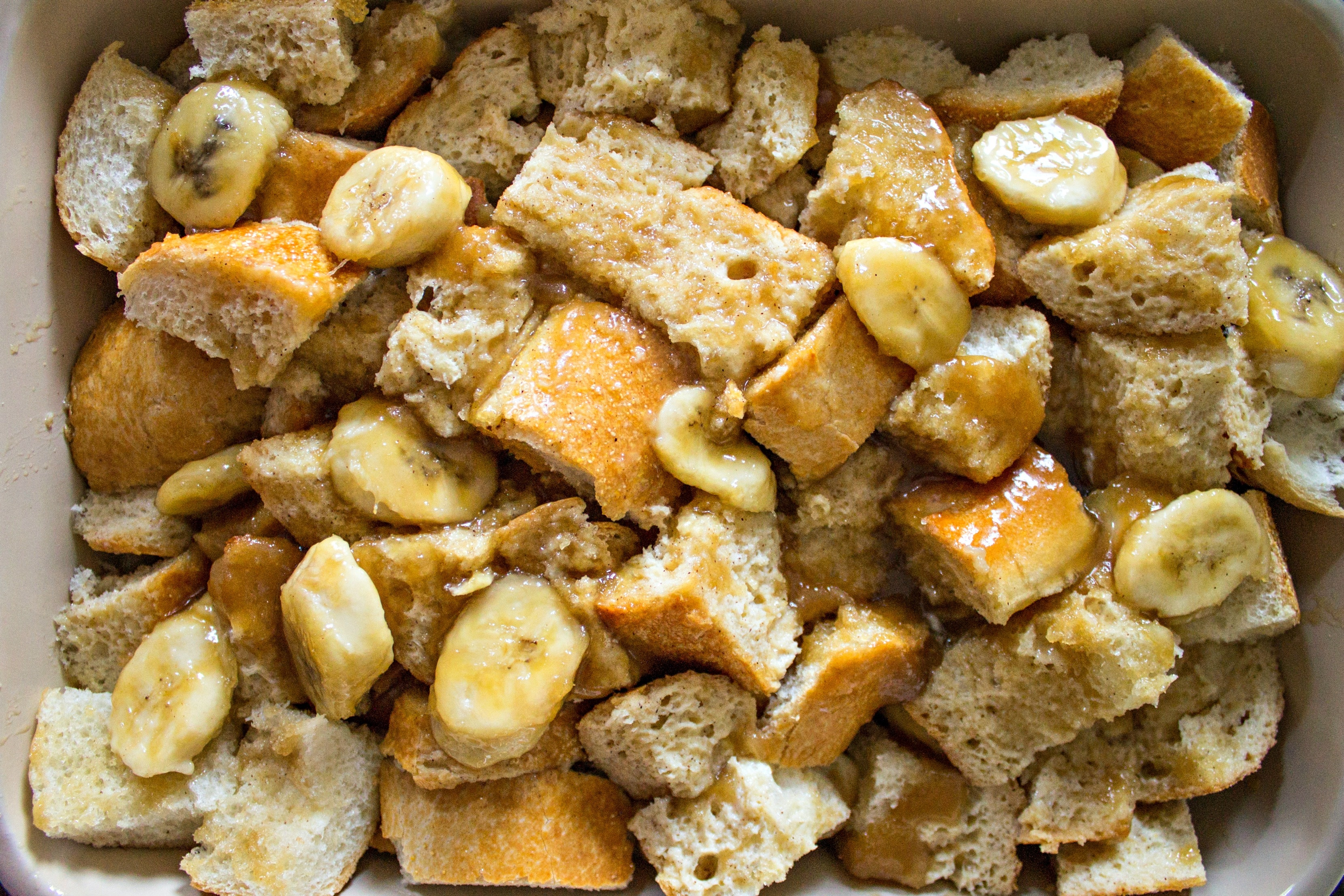 French toast pieces and bananas in a casserole dish