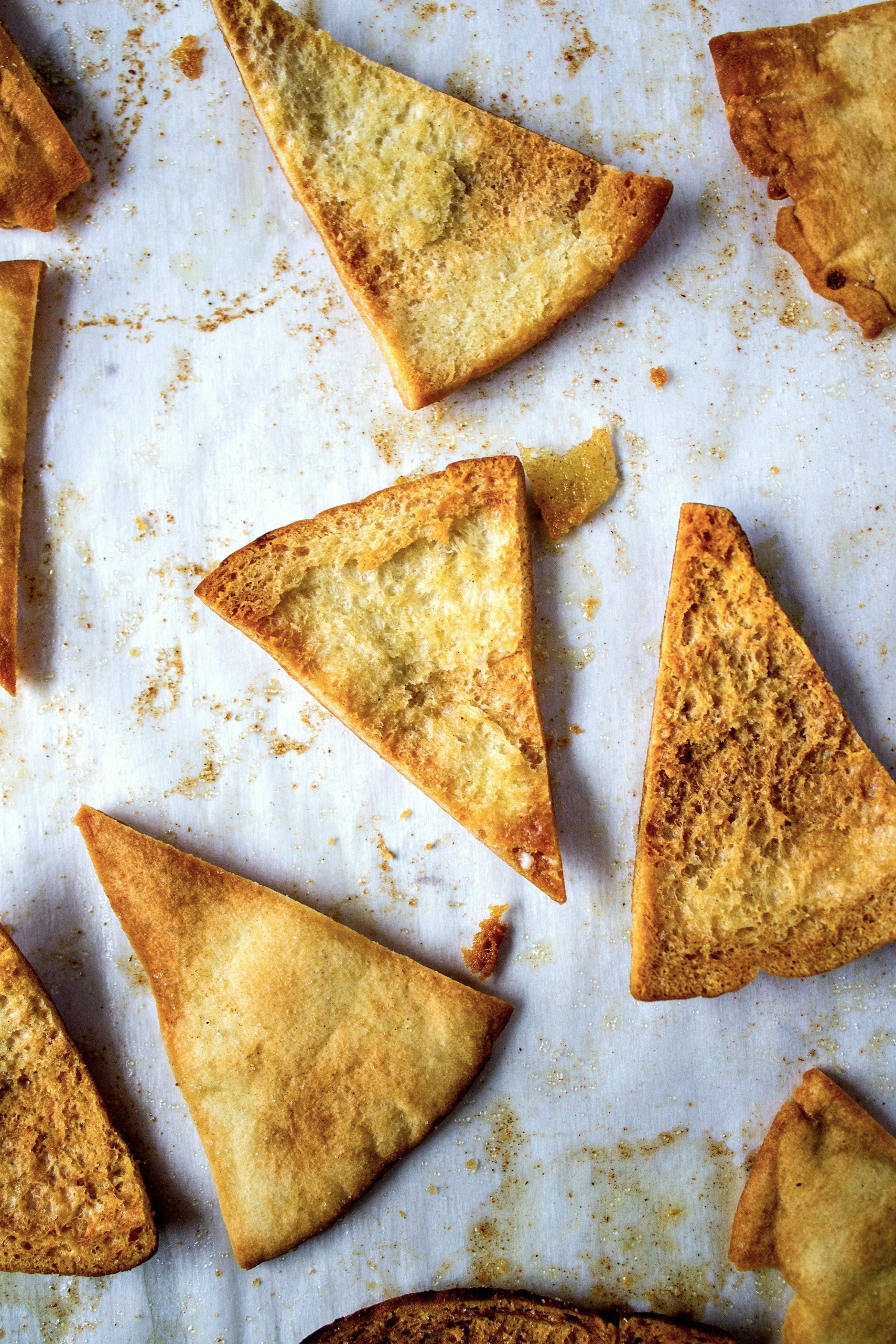Sage and Browned Butter Pita Chips on a wax paper sheet