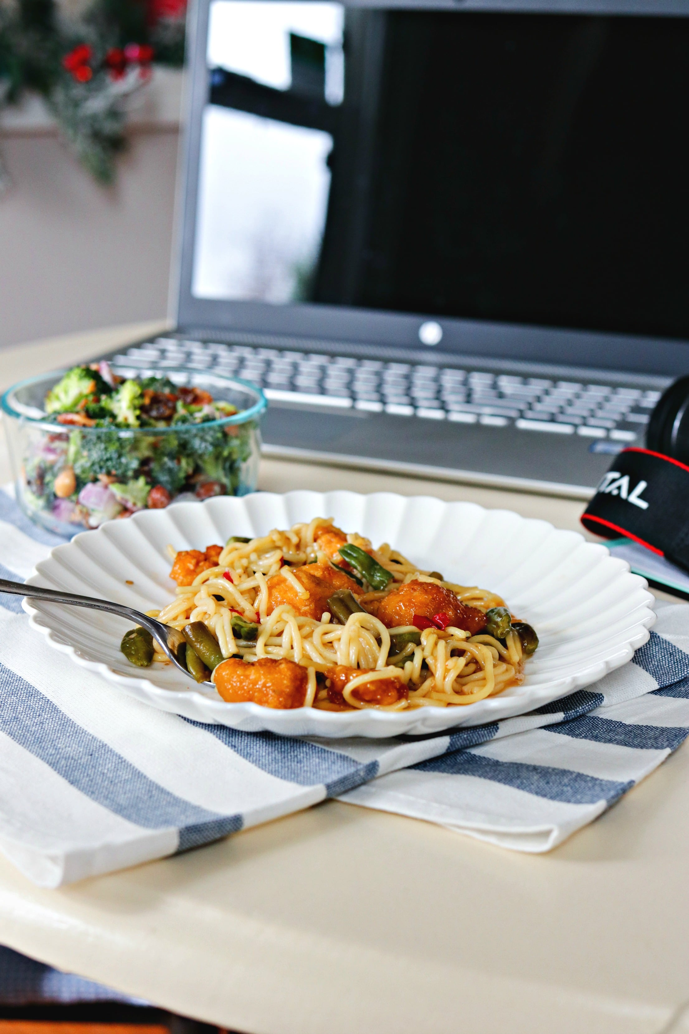 Lean Cuisine and Fresh Broccoli Salad with Crispy Bacon in front of a laptop