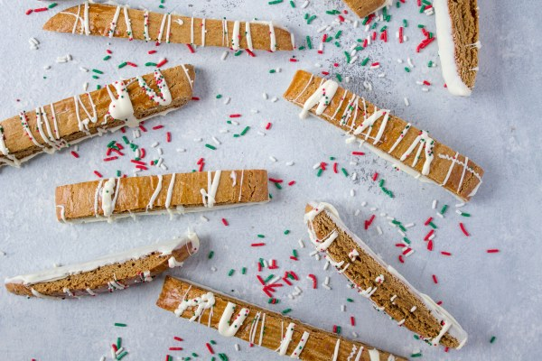 Gingerbread Biscotti - These gingerbread biscotti are baked and then dipped in almond bark. The perfect accompaniment to your coffee or hot chocolate! And they make great food gifts, too!