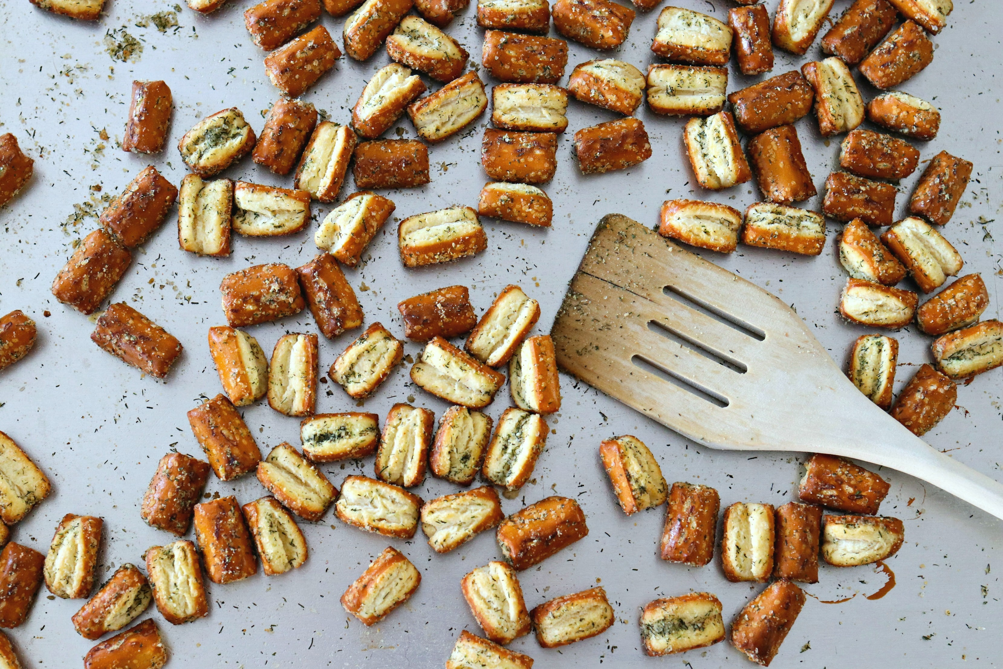 Easy Garlic Parmesan Pretzels on a cooking sheet with a spatula