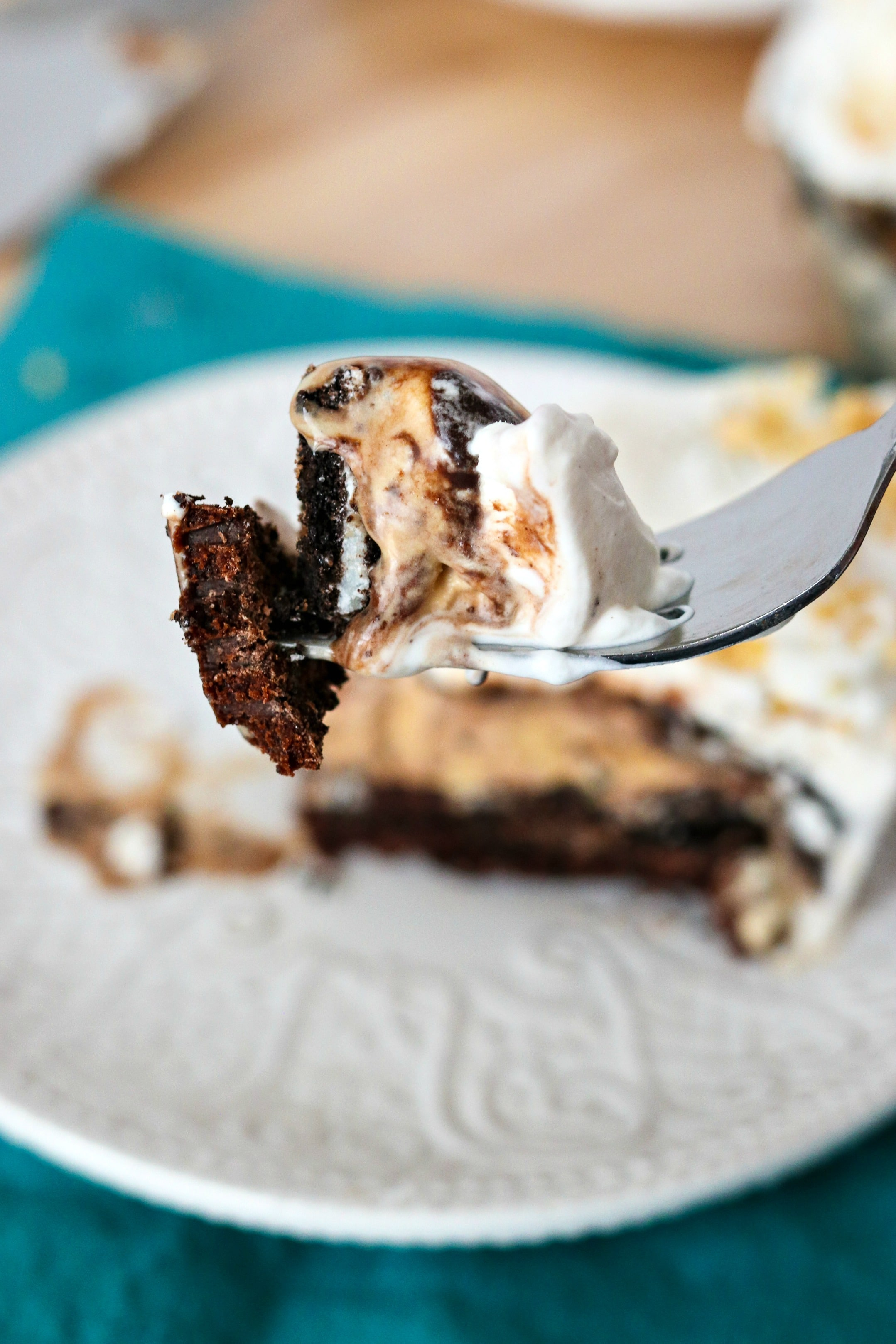 The Ultimate Brownie Sundae pie - This brownie sundae pie is oh so decadent but worth every bite! Made with a brownie bottom, topped with Oreos, your favorite ice cream, hot fudge, whipped cream and a cherry. You're gonna want this pie for your next birthday!
