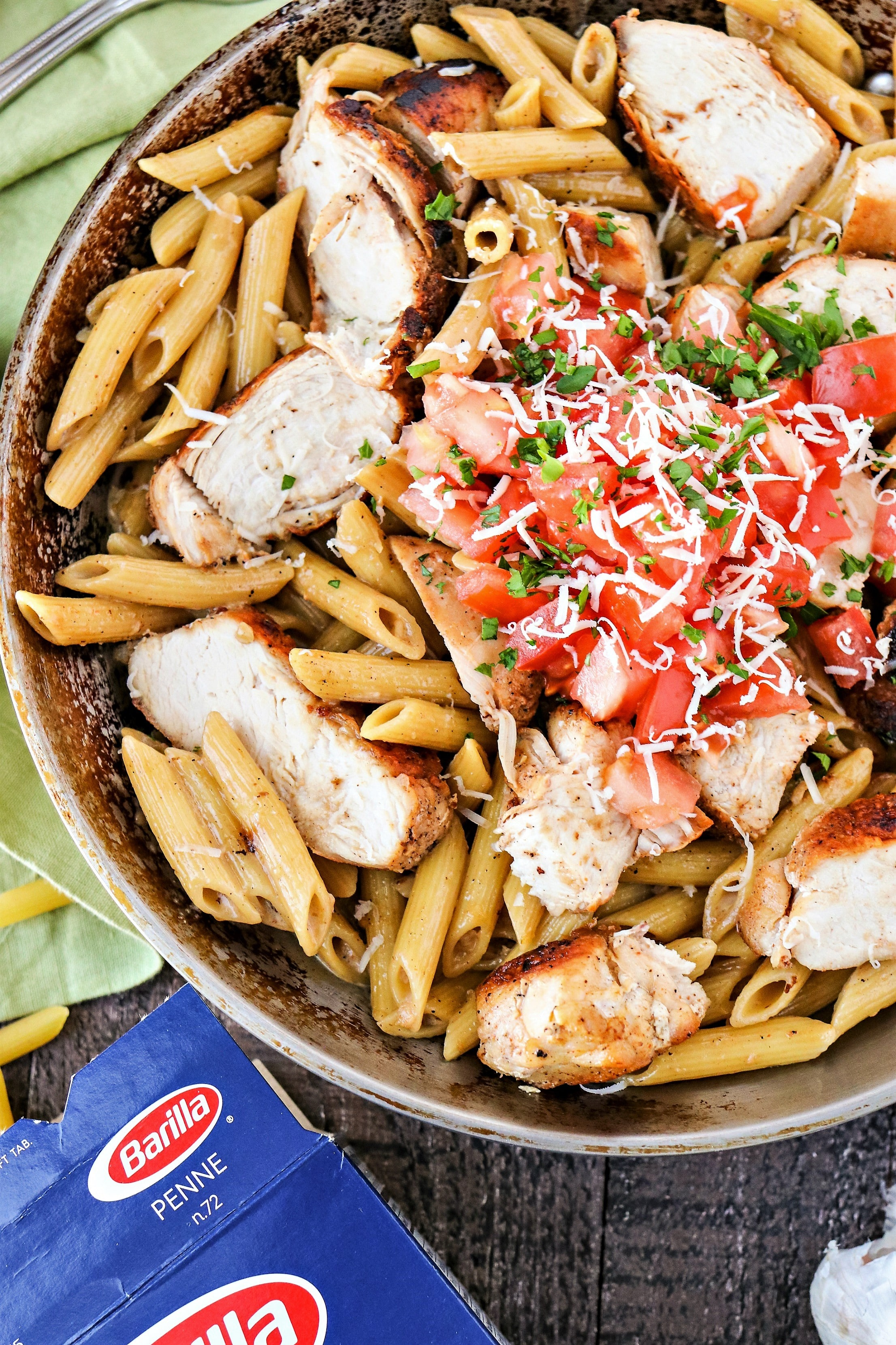 Cajun Chicken Pasta -Spicy Cajun chicken tossed in yummy Barilla penne pasta with a homemade Parmesan cream sauce. Such a perfect dish for date night! #WonderfulYourWay #ad