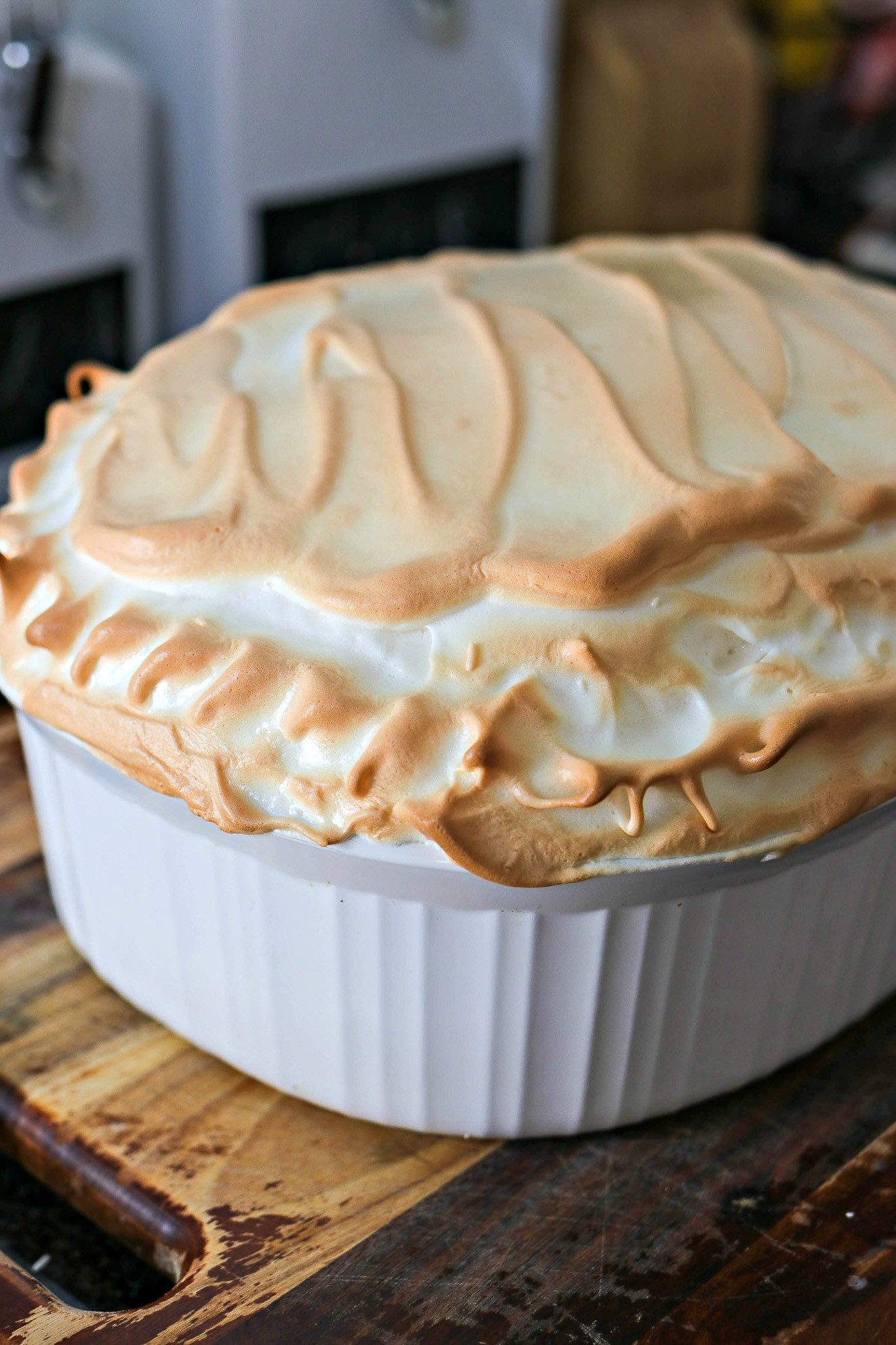 Warm Banana Pudding - Made with pound cake, homemade vanilla pudding, sliced bananas and topped with toasted meringue, this Southern warm banana pudding taste so velvety smooth that you'll never want to make another banana pudding ever again!
