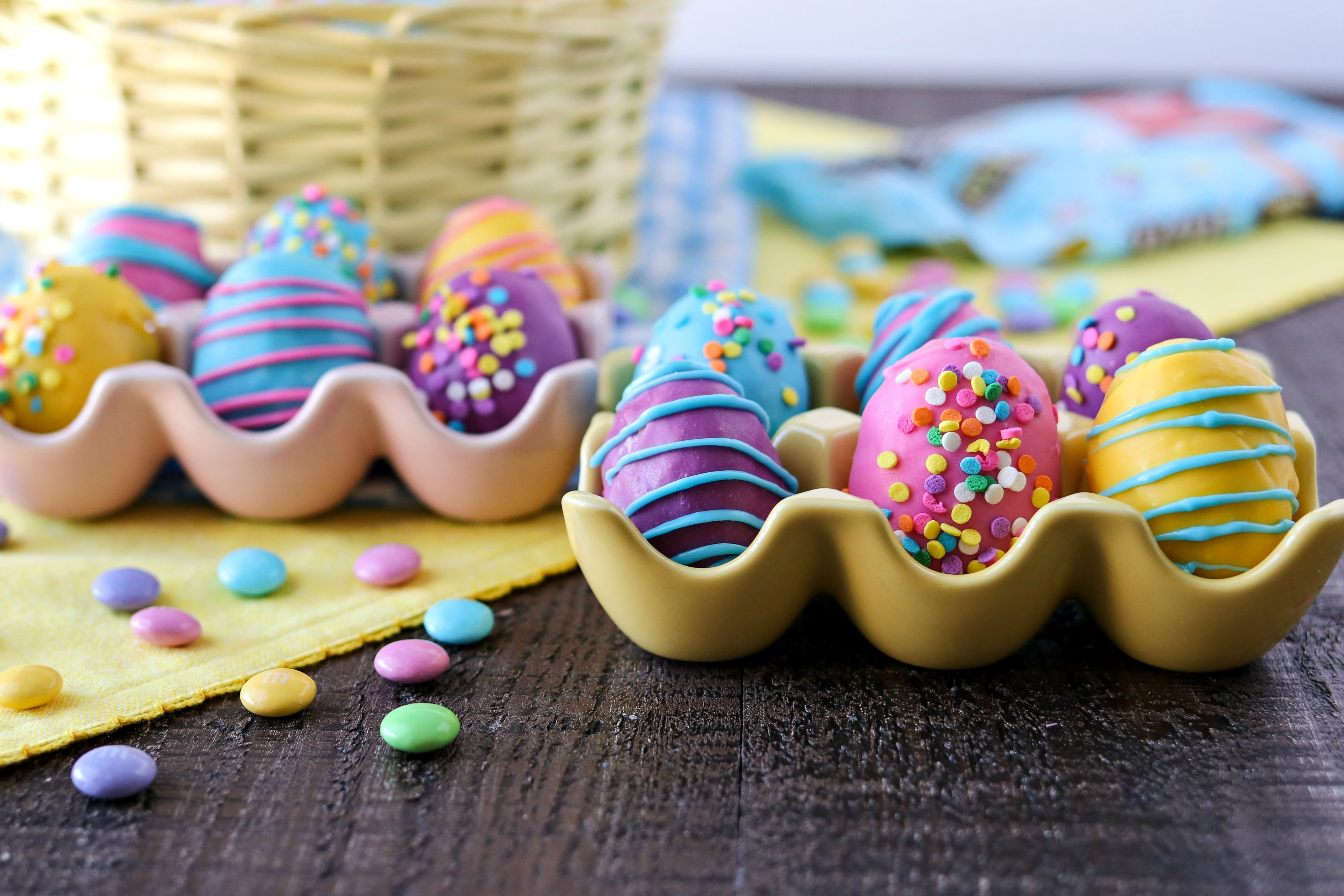 Cookie Dough Easter Eggs with M&M's® - Chewy edible chocolate chip cookie dough truffles with M&M'S® milk chocolate candies, rolled into egg shapes, and dipped into fun colored candy melts to make them look like Easter eggs. The perfect treats to make for Easter! #SweeterEaster